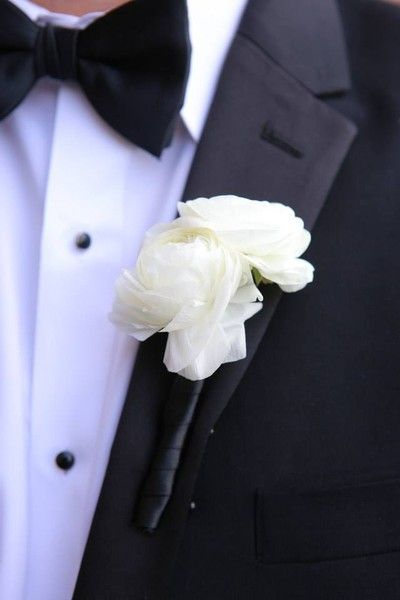 Classic black tux with a sweet and simple white ranunculus boutonniere {Brian Phillips Photography}