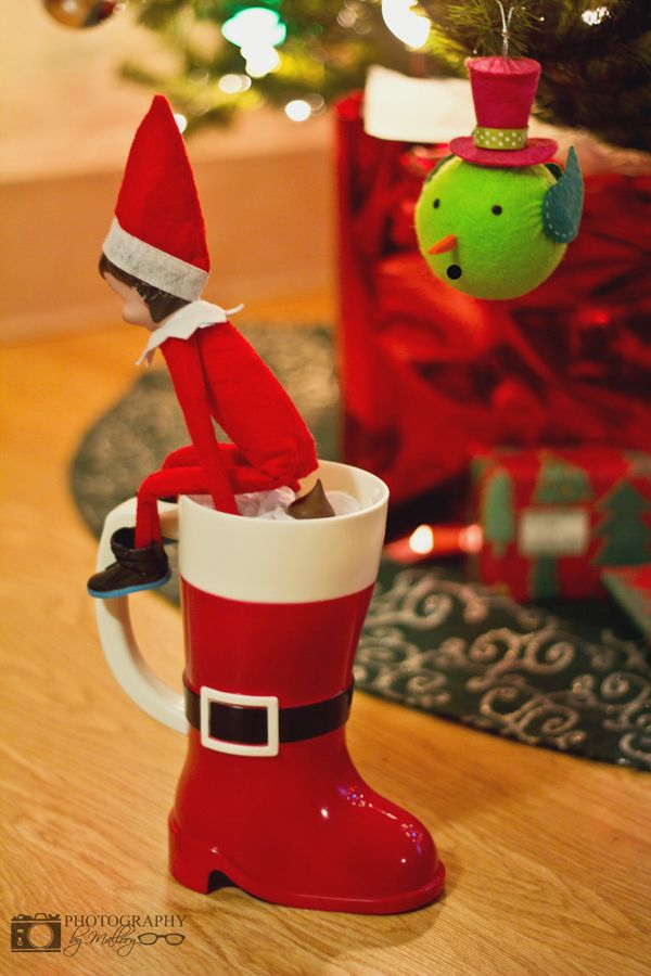 Elf on the Shelf. Pooping in Santa's boot. | Photography by Mallory