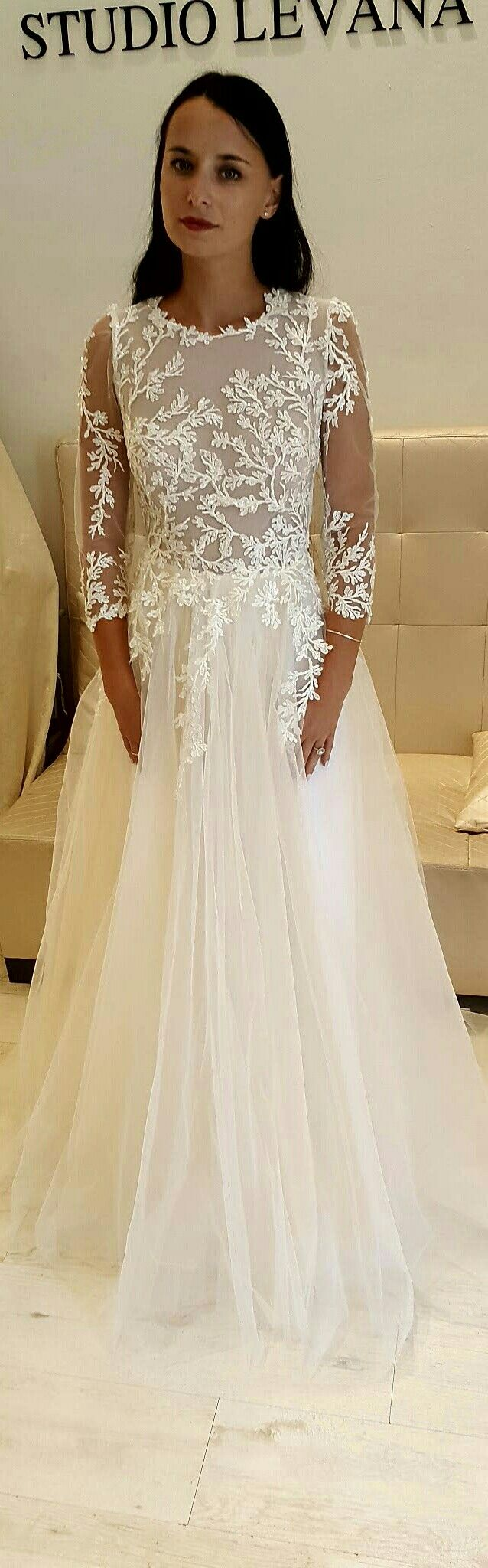 Modest wedding gown with high neck line sleeves and tulle skirt