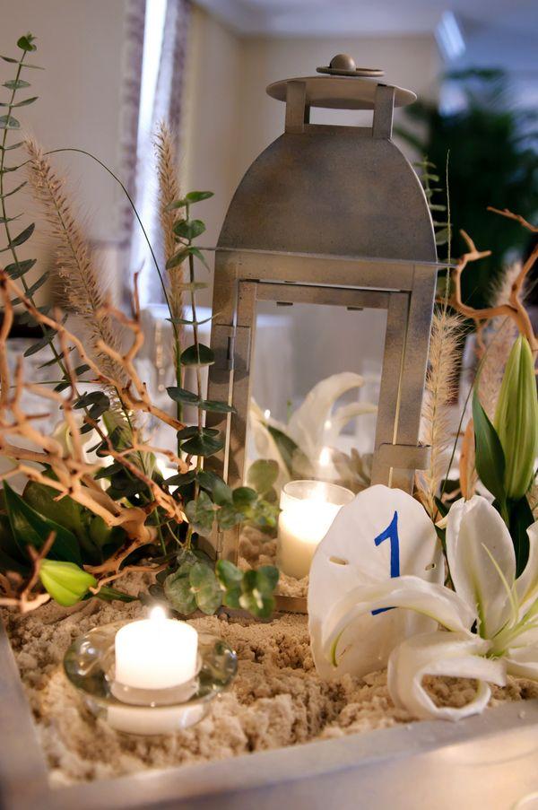 Beach wedding lantern sand centerpiece succulent inspired