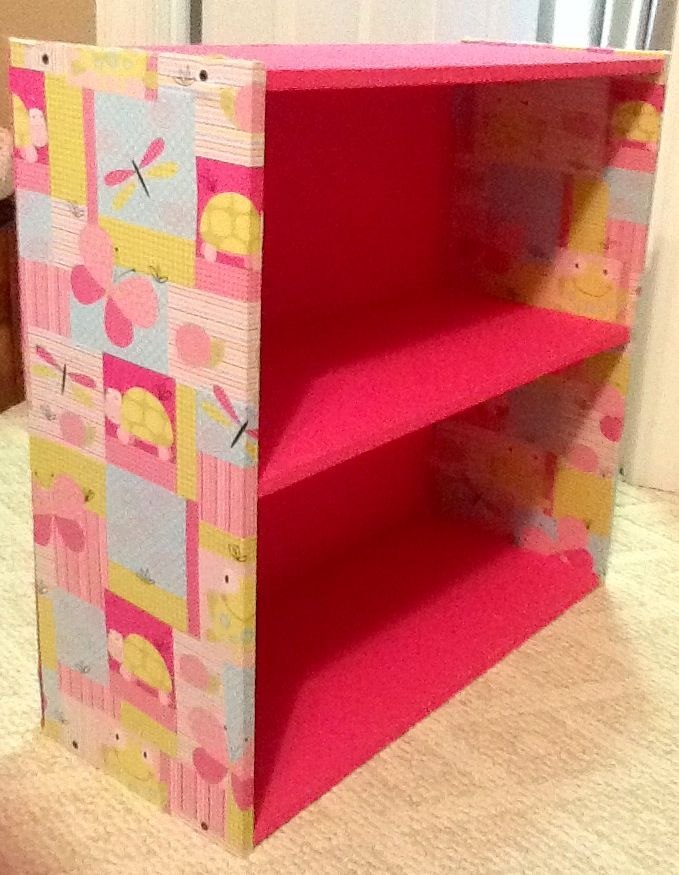Covered A Bookshelf With Fabric Spray Glue And Hot