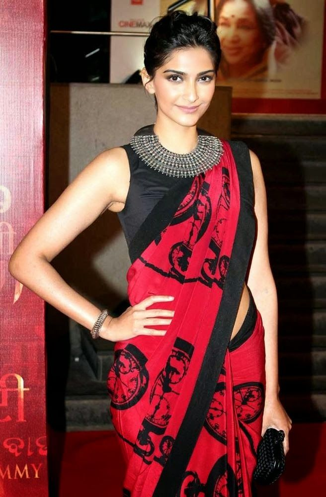 Sonam Kapoor in a red and black saree and blouse. Love the ...