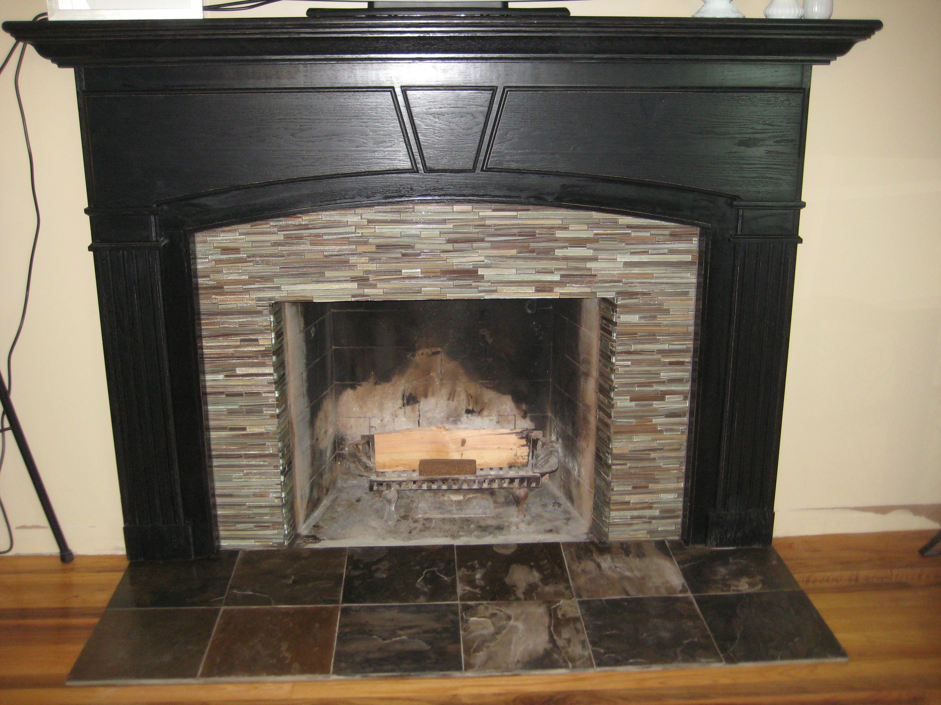 Mosaic tile fireplace surround ideas take to make the fireplace accessories furniturestunning glass mosaic fireplace surround with black wooden fireplace mantle and ceramic tile floorbeautiful glass mosaic fireplace dailygadgetfo Images