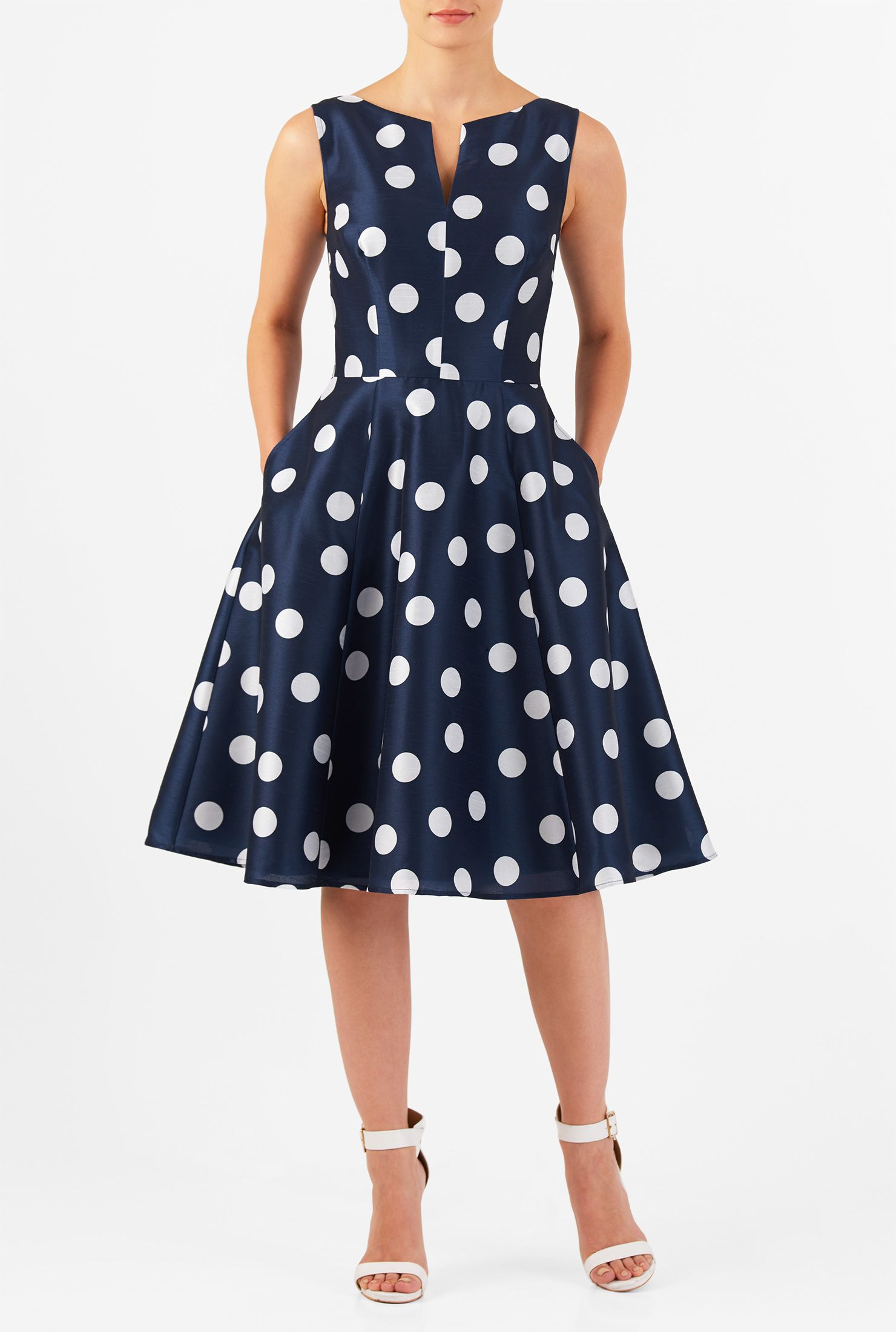 facbdcded94d A split neck tops our polka dot print polydupioni dress designed with a  fitted tank bodice and seamed waist atop a full flared skirt.