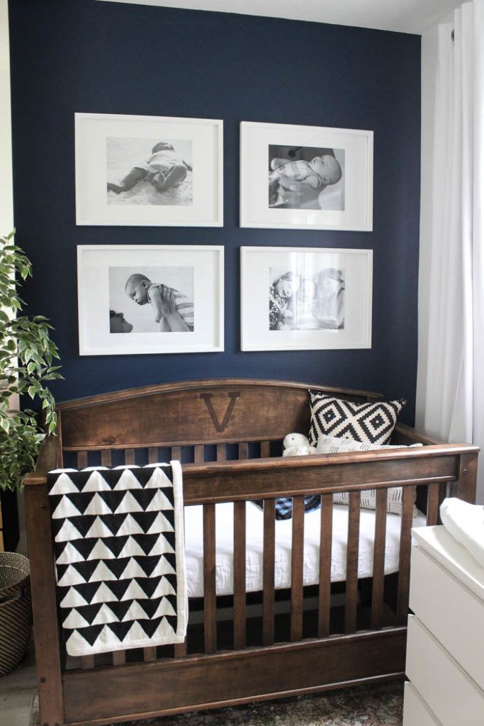 Beautiful ideas for a small modern nursery! This tiny baby room is off to the side of the master bedroom. Love the simple decor, from the navy wall to the brown crib and the beautiful gallery wall! #nurseryideas