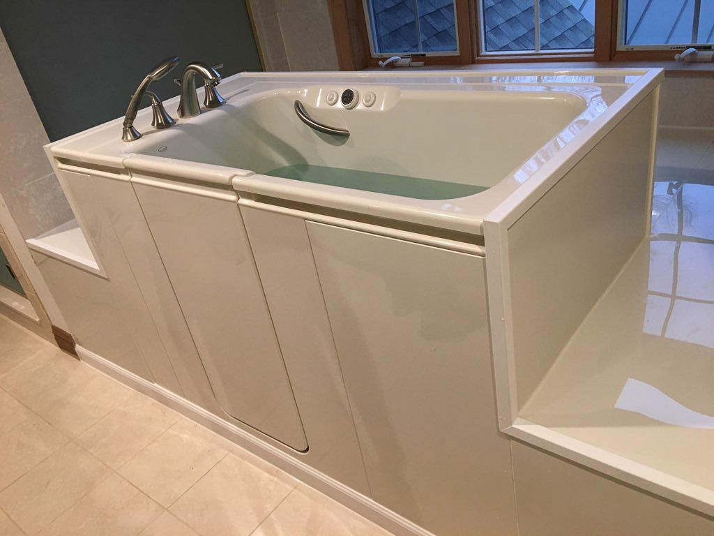This Walk In Bath By Kohler Was Installed In Place Of The Existing Bathtub And Will Allow Seniors To Age In Pl Walk In Tubs Luxury Bathroom Vanity Walk In Bath