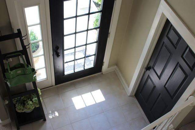 black interior doors and knobs with white pine board trim they used 1 x 6 boards for the top of