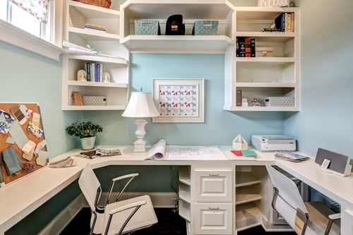 wrap around office desk. Corner Office Off Of The Kitchen Featuring Wrap Around Desk And Built In Shelving.