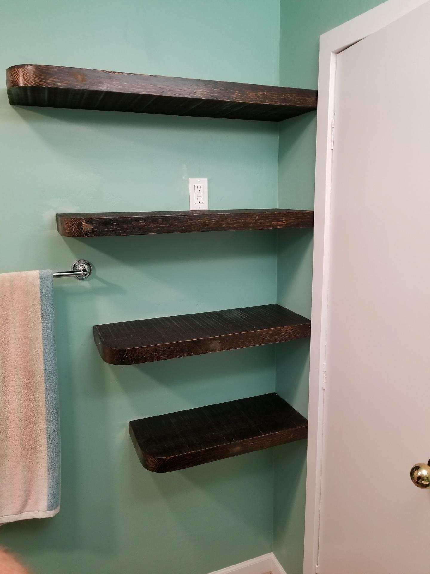 Resawn free floating fir shelves gives this bathroom a masculine ...