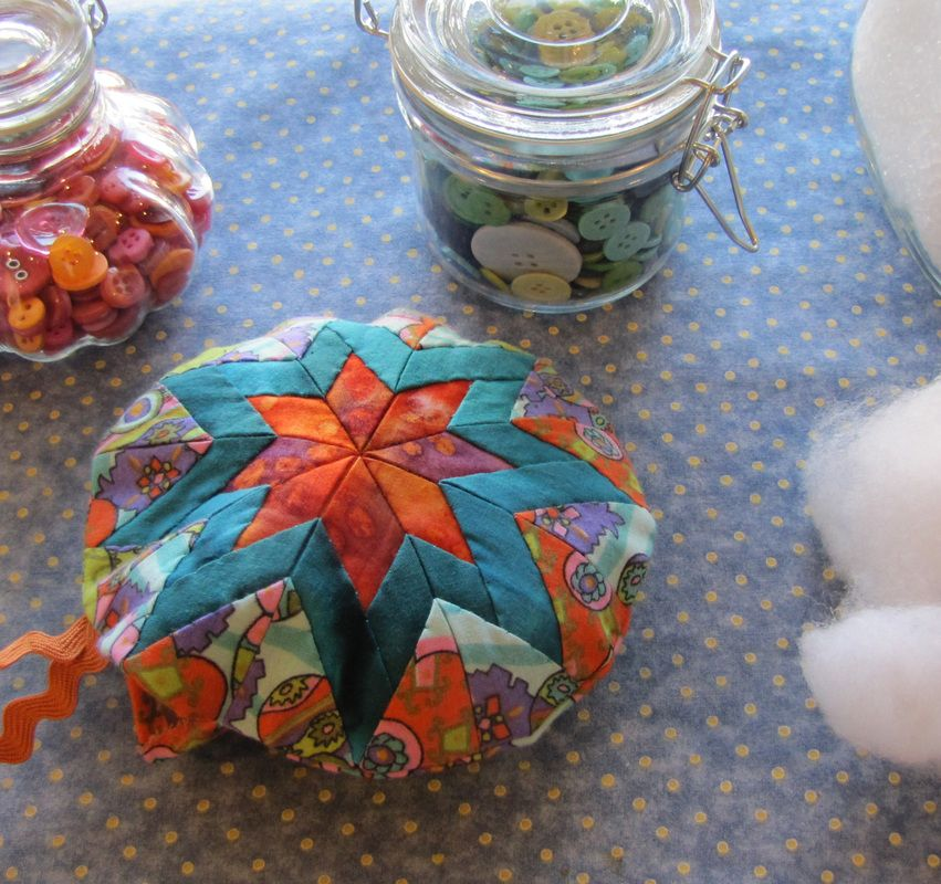 How-to tutorial for making a folded star pincushion.