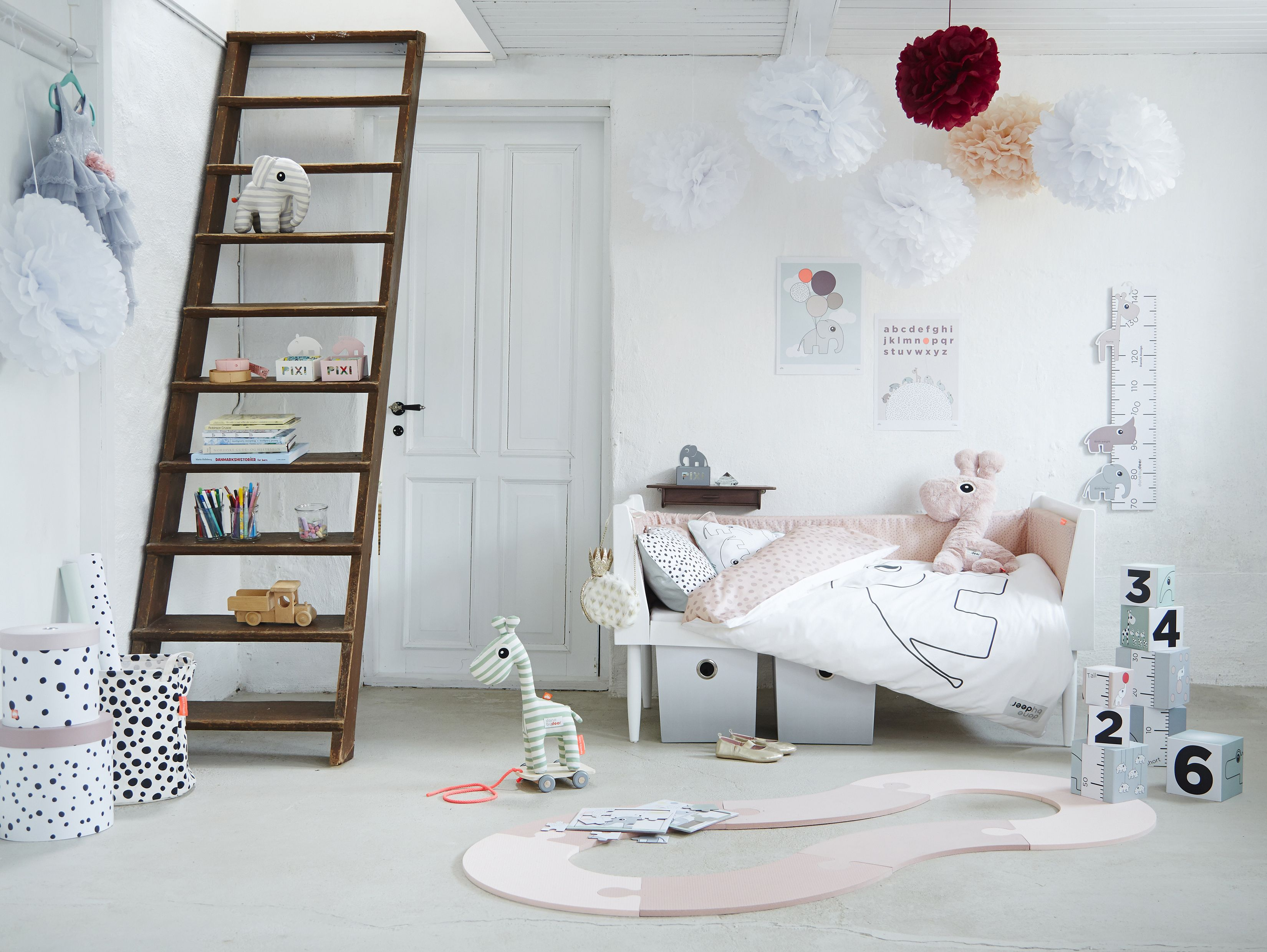 Decorate a girls room in powder tones and with room to gro play