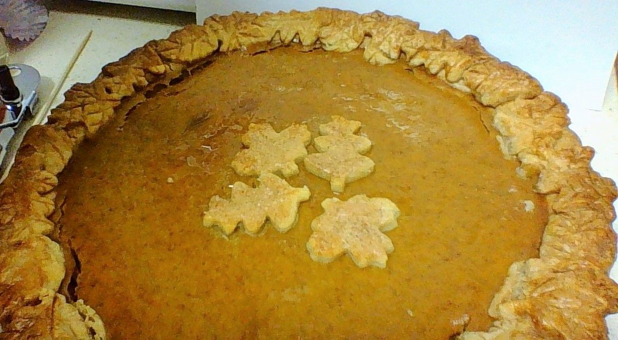 Classic Libby's Pumpkin Pie and attempt at decorative crust. Next time put leaves on the last 20 minutes.