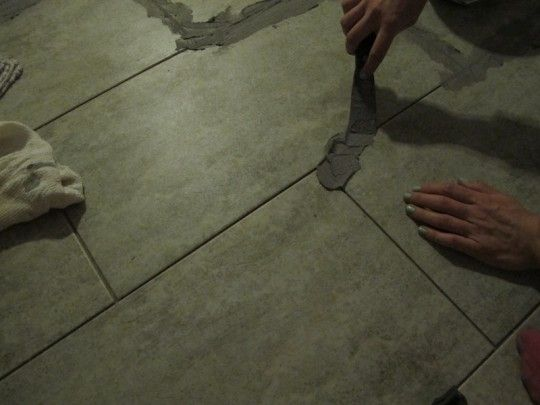 Using A Putty Knife To Gently Install Grout Basement Update
