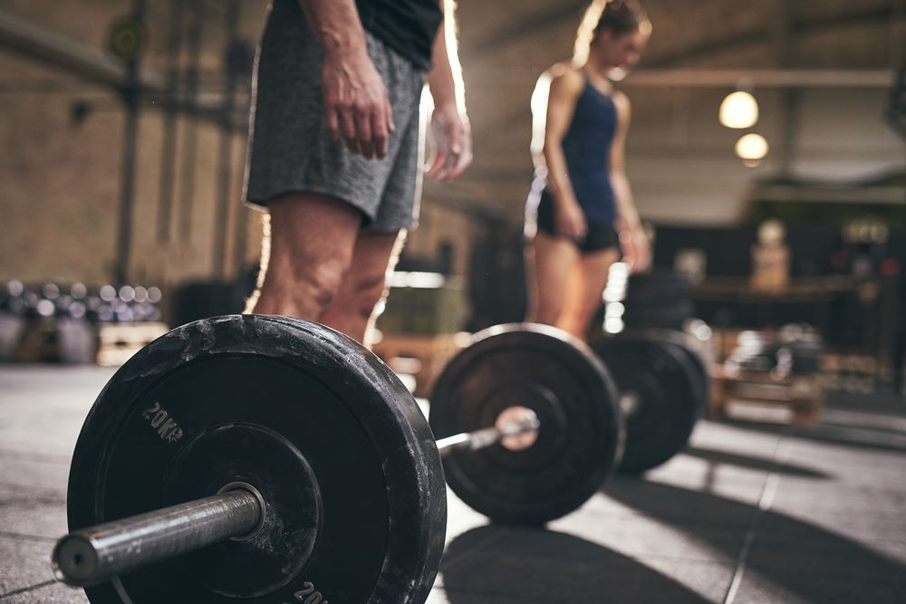 Fit People Standing Barbells Before Exercise Group Fitness Classes Fitness Class Build Muscle