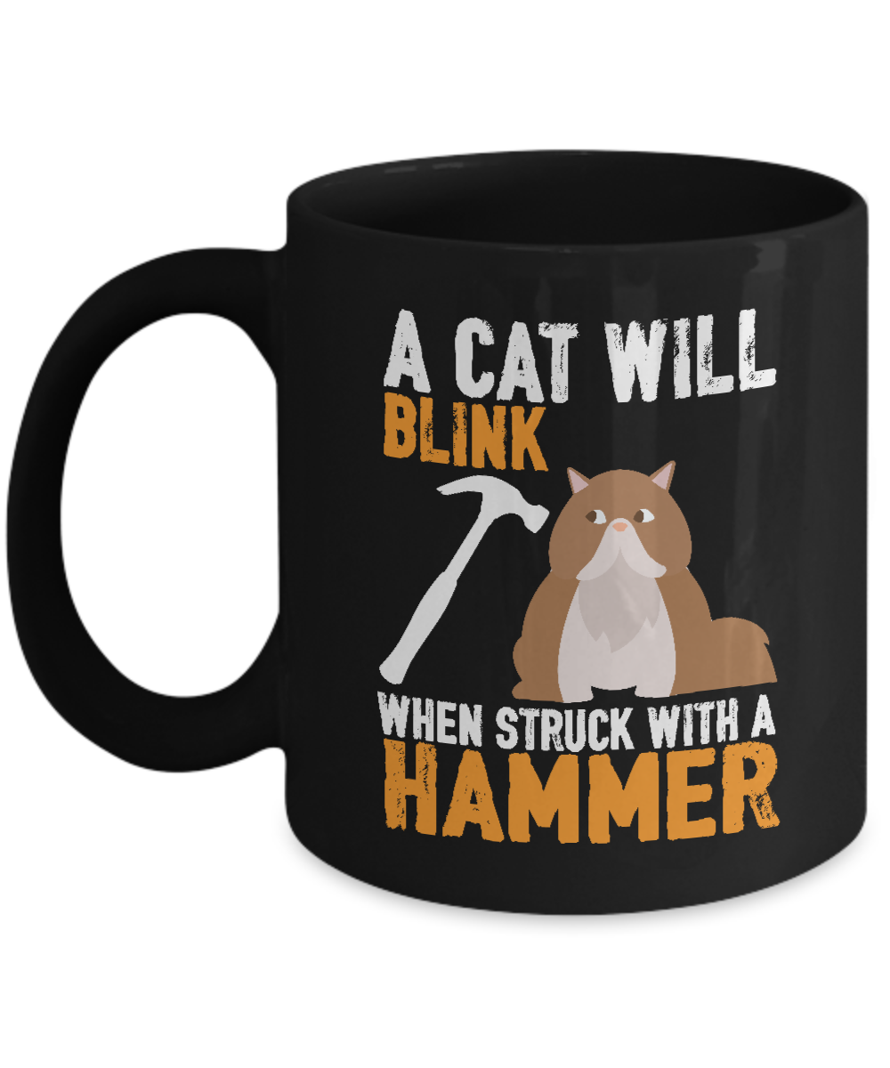 "This funny ""A Cat Will Blink When Struck With A Hammer"" mug is perfect for anyone who loves cats and puns.  Mugs are printed to order in the USA. Printed on both sides. Microwave safe. To extend the longevity of the mugs we recommend hand washing."