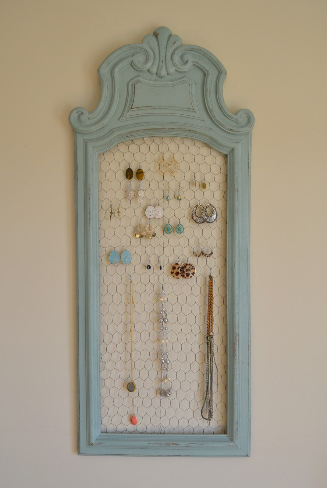 Add chicken wire to repurposed mirror or picture frames to create use chicken wire and an old cabinet door picture or mirror frame to make a unique jewelry holderdisplay jeuxipadfo Image collections