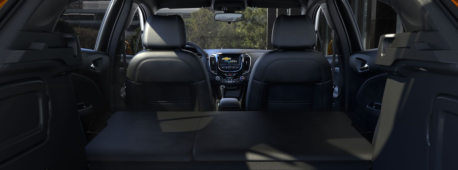 The 2017 chevrolet cruze hatch features generous rear cargo space