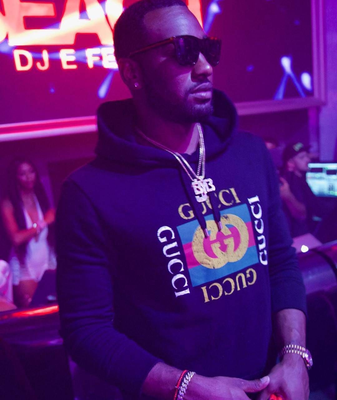 50a4c32c5  NBA star  JohnWall rocking  Gucci sunglasses and  Gucci logo hoodie.   morethanstats
