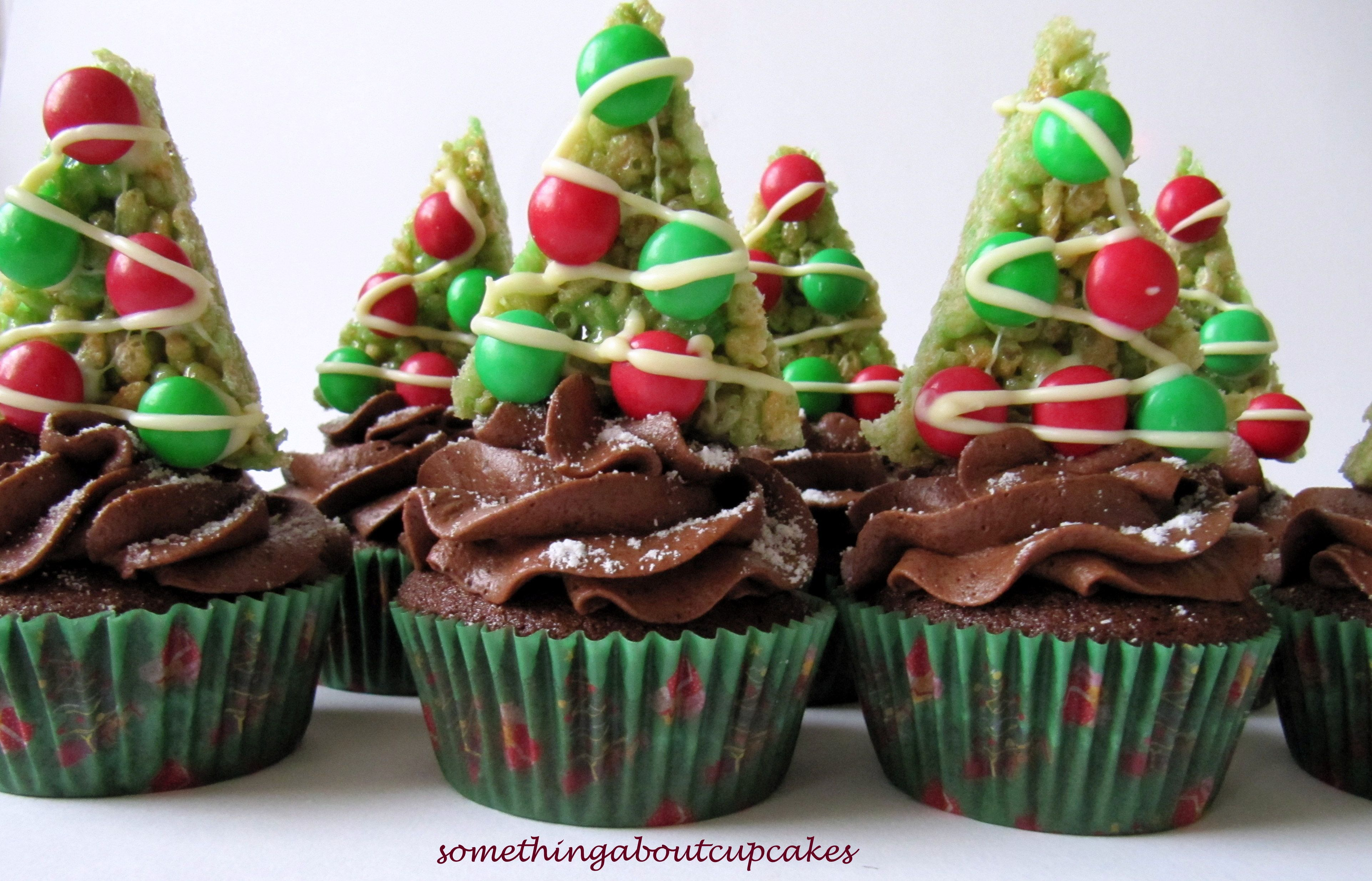 Chocolate cupcakes with a rice krispie tree on top christmas