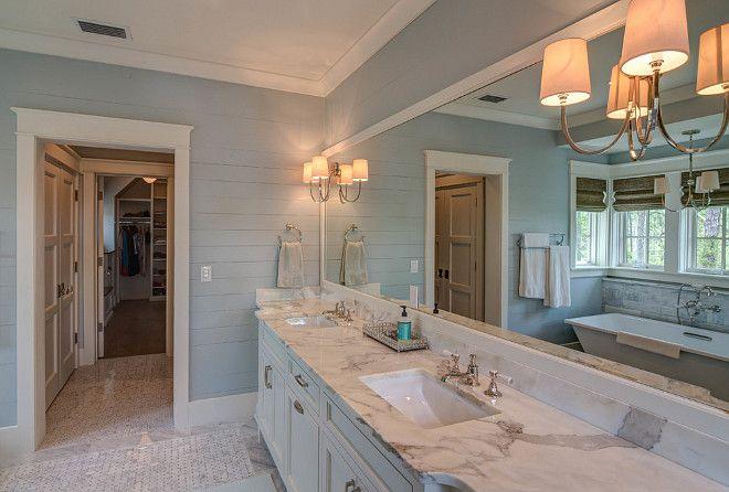 Master Bathroom Beach House blue bathroom shiplap walls. blue bathroom with white vanity