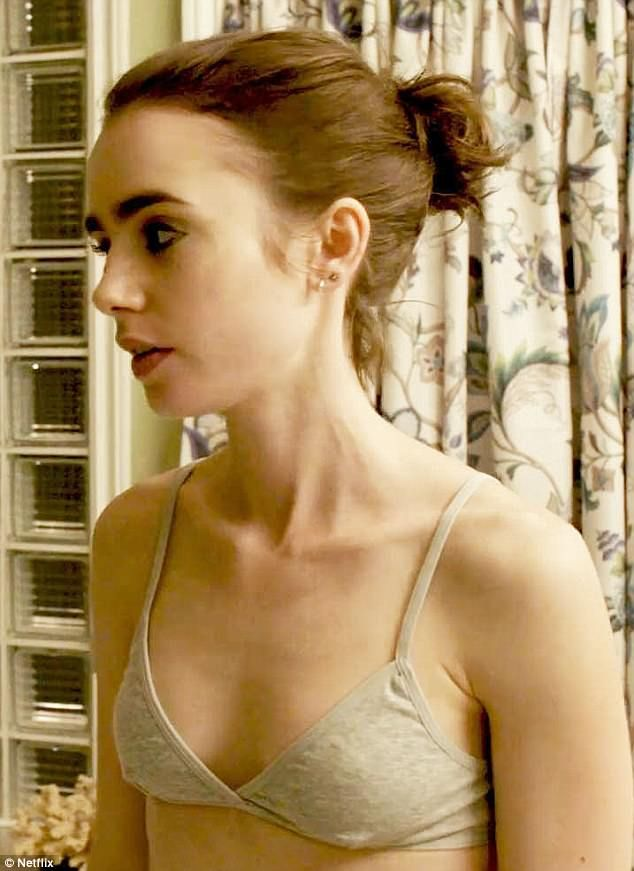 Lily Collins flaunts her tummy in cutaway costume in Italy