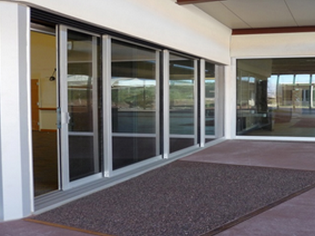 Replacing Your Standard Door Into The Sliding Glass Door Is A Clever Move It Offers A Contemporary Design And F Sliding Glass Door Storefront Glass Glass Door