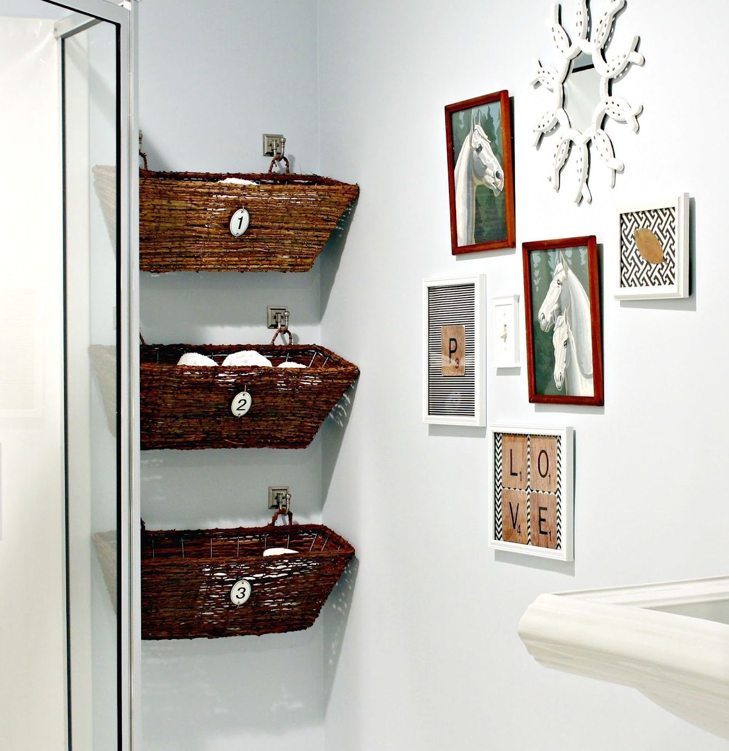 Unique and creative bathroom decor with cute framed wall arts