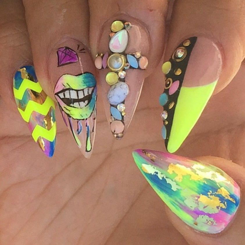 neon stiletto nails with gems