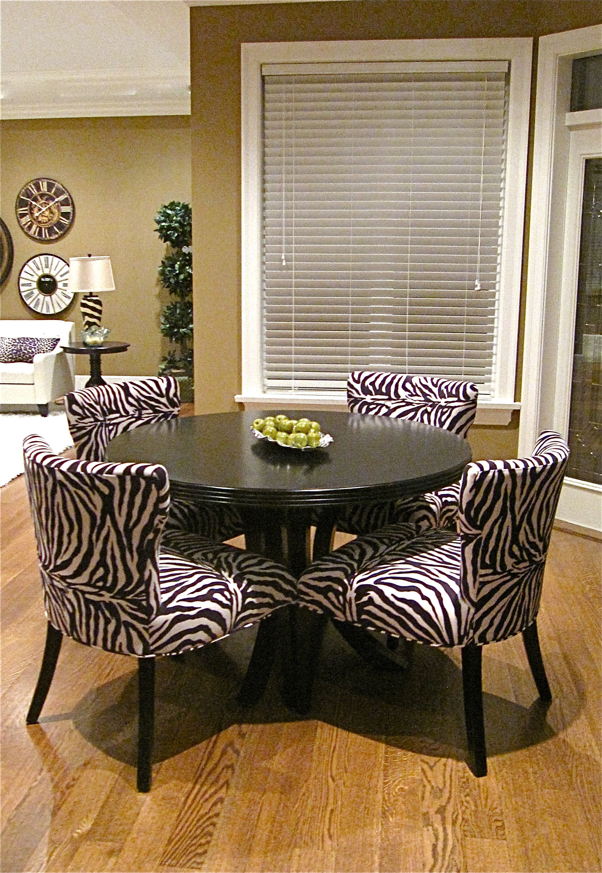 Breakfast Nook features round table & zebra chairs coordinated