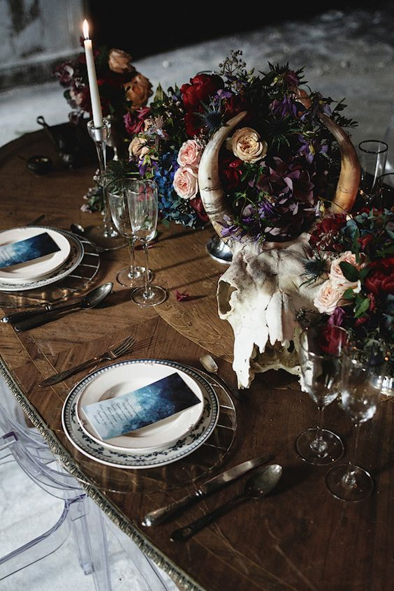 21 moody table setting with a skull and flower centerpiece ...