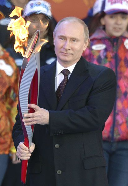Russian President Vladimir Putin holds a torch in Moscow on October 5, 2013, to start the relay across Russia, as the Olympic Flame for the XXII Winter Olympic Games Sochi 2014 arrived in Russia . AFP PHOTO / ALEXANDER NEMENOV (Photo credit should read ALEXANDER NEMENOV/AFP/Getty Images)