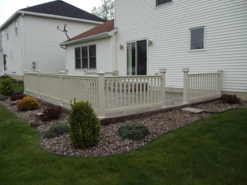 Our Vinyl Railings And Decorative Solar Lights Accent This Stamped Concrete  Patio.