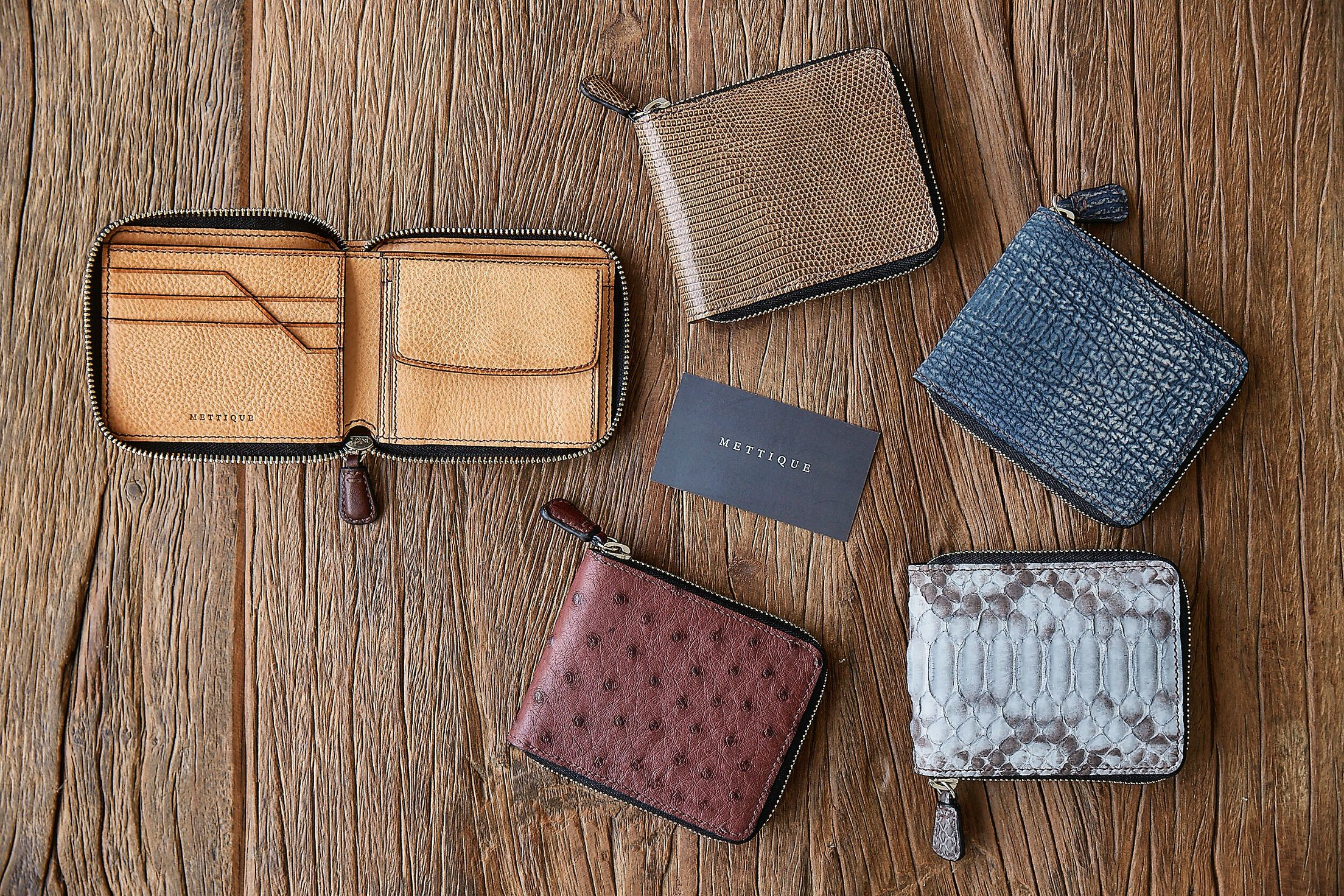 #METTIQUE #handstitch #leatheronly  #METTIQUE #TLZ2 wallets in #lizard, #shark, #ostrich and #python and Italian #cowhide lining, #handstitched with bees waxed thread.   WWW.METTIQUE.COM