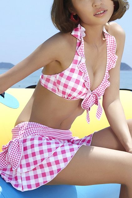 Swimsuit crafted in spandex and polyester, featuring halterneck design, check to main, skirt style, flouncing to chest.$82