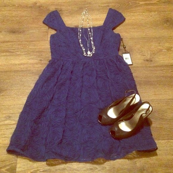 "Adrianna Papell Formal Dress Adorable royal blue dress with rosette like design. I'm 5'1"" and it hits right at my knees. Size 10. Adrianna Papell Dresses Midi"