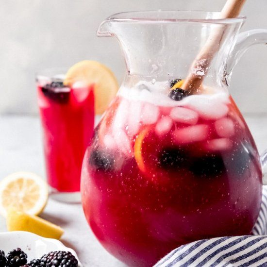 Homemade Blackberry Lemonade is the perfect drink for spring or summer!  Our family loves this easy lemonade recipe with a fun berry twist! #easylemonaderecipe