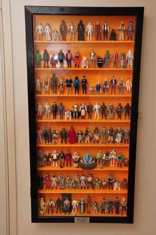 Collection Of Vintage Star Wars Figures In A Custom Cabinet