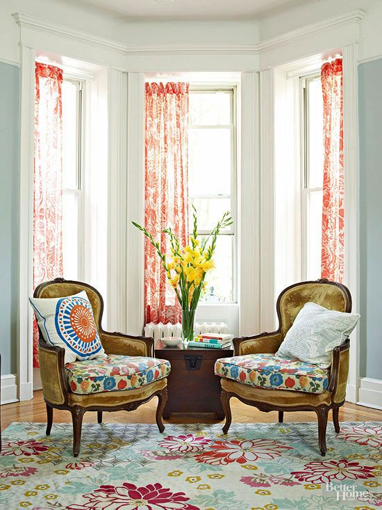 A Bay Window Frames A Pair Of Chairs In This Seating Area Because