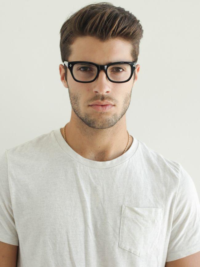 Simple white tee, stubble, glasses