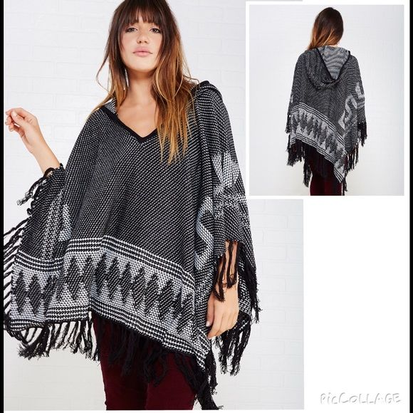 NEW Hooded Fringe Poncho Sz L/XL Drape yourself in something cozy and incredibly trendy with this comfy hooded poncho! It features soft sweater knit body with a two-tone knit pattern and geo border patterns. Poncho also features fringe trim along the hem and solid trim on the neckline and hood.  Hooded Open Sleeves Midweight Acrylic Hand Wash Brand New Without Tag  Sweaters Shrugs & Ponchos