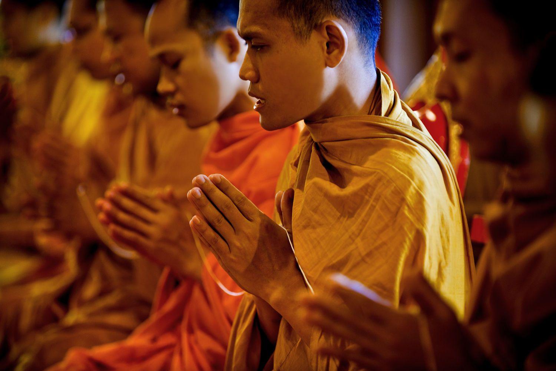Photograph Novice buddhist monk to dress. by Jakkree