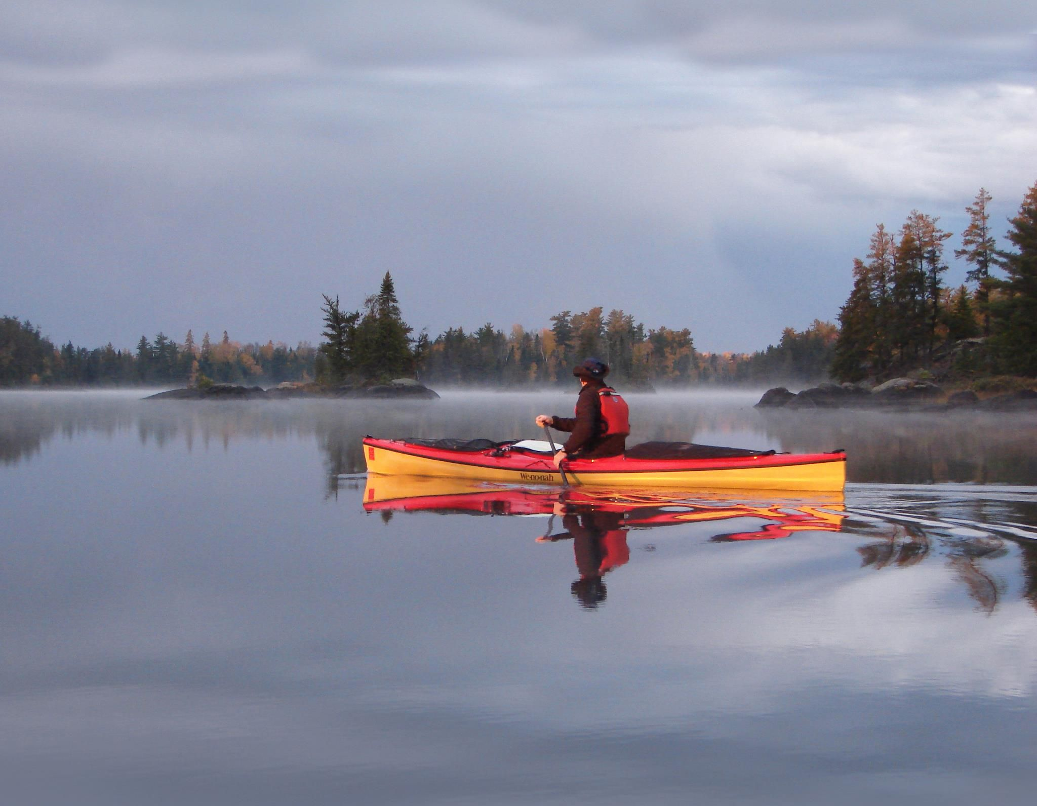 From Wenonah Canoe: Plant manager Mark A  paddles a Canak on