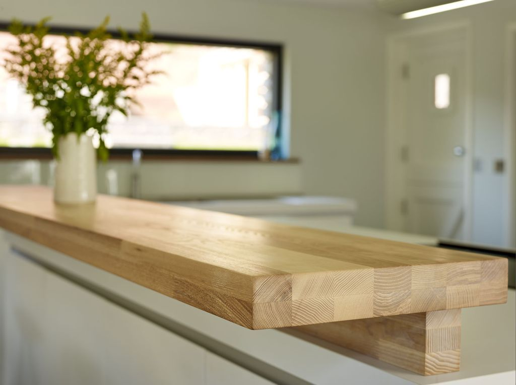 Open Plan Kitchen Breakfast Bar.  This solid wood breakfast bar is made of ash and slightly raised to offer screening the open plan kitchen island bulthaup wooden bartop