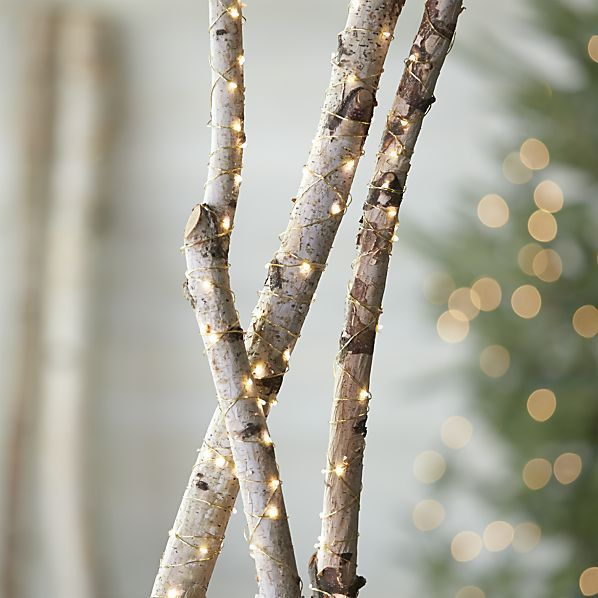 Tiny twinkling lights on a slender golden wire wrap trees garlands tiny twinkling lights on a slender golden wire wrap trees garlands and shrubbery with an workwithnaturefo