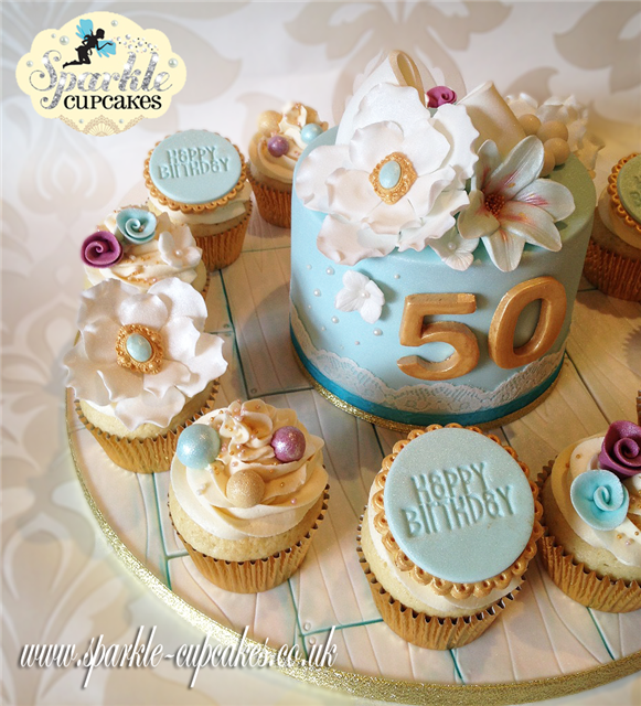 Vintage 50th Birthday Cake with matching cupcakes on wood effect