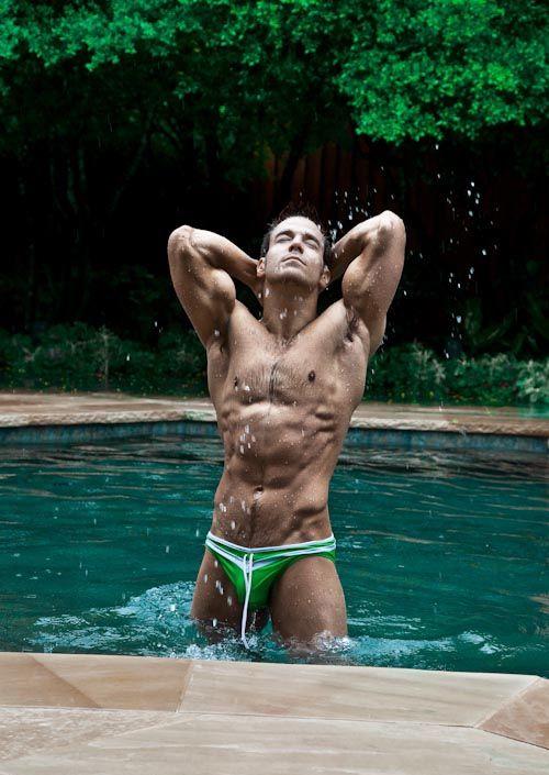 Adult film star Chris Rockway wearing a green speedo in the pool