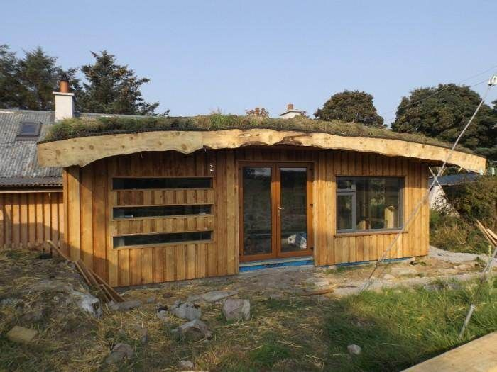 timber frame with a strawbale insulated green roof roundwood and