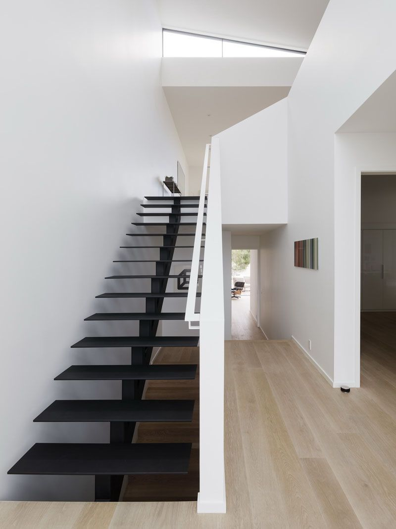 Minimalist Black Painted Steel Stairs Lead To The Upper Floor Of This Modern House Modernstairs Blackstair Home Stairs Design Stairs Design Staircase Design