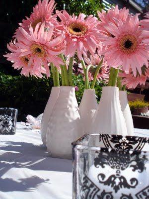 Gerber daisy baby shower centerpieces were clusters of pink gerber daisy baby shower centerpieces were clusters of pink gerbera daisies in white vases junglespirit Gallery