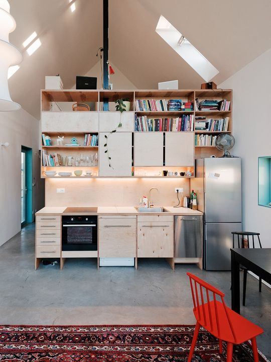 Inside, the custom-built casework and splashes of blue and red stand - como disear una cocina